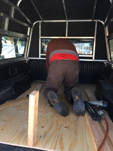 Dave building bed in the truck camper