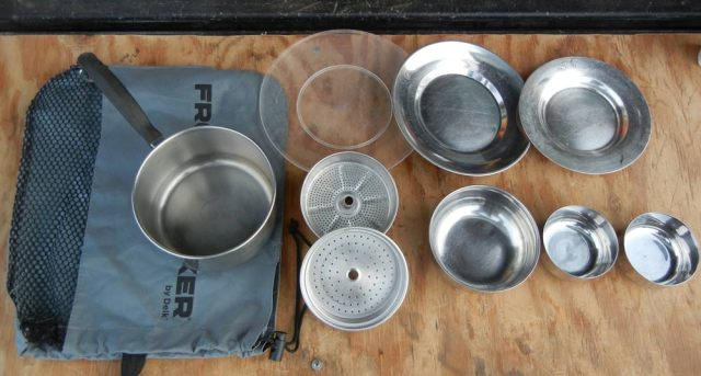 Open bag of kitchen pots for truck camping